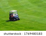 Golf Cart With Golf Clubs On A...