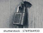 Old Iron Padlock On Locked...