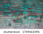 Small photo of Weathered blue wooden background texture. Shabby wood teal or turquoise green painted. Vintage beach wood backdrop. Shabby decrepit wooden boards. Wood lamellas. Blue rough painted planks surface.