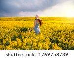 Young Woman Walking Flowering...