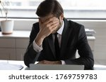Frustrated Male Employee Sit At ...