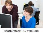 co workers smiling in... | Shutterstock . vector #176983208