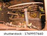 Old Rusty Steering Wheel In A...