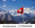 swiss flag on montain top near jungfraujoch (the top of Europe)