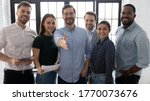 Small photo of Millennial male leader stretch out his hand for handshake welcoming new employee invites newcomer to corporate team, group showing amity, human resources, boss greets clients express respect concept
