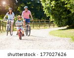 asian family on cycle ride in... | Shutterstock . vector #177027626