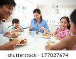 asian family sitting at table... | Shutterstock . vector #177027674