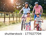 asian family on cycle ride in... | Shutterstock . vector #177027704