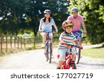 asian family on cycle ride in... | Shutterstock . vector #177027719