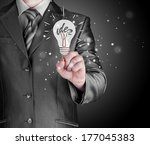 business man touching light of... | Shutterstock . vector #177045383