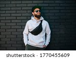 Handsome hipster guy wearing...