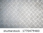 Industrial Background. Metal Diamond Plate Known As Chakkered or Tread Plate. Metallic Pattern.  - stock photo
