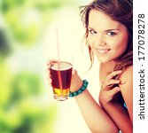 Young Woman In Bikini Drinking...