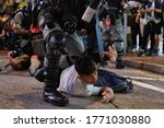 Small photo of Hong Kong/China-07/01/2020: A pro-democracy protestor is detained by police officers during the march against the national security legislation.