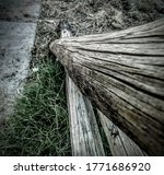 Old Broken Fence With Grass At...