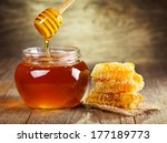 jar of honey with honeycomb on... | Shutterstock . vector #177189773