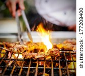 chef grilling lamb ribs on flame | Shutterstock . vector #177208400