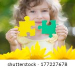 Child Holding Puzzles In Hands...