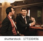 two young men in suits behind... | Shutterstock . vector #177233456