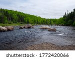 A River With Large Boulders...