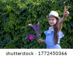 cute girl in a blue dress and... | Shutterstock . vector #1772450366