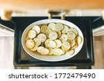 Small photo of thinly sliced summer squash or green zucchin roasted in the oven, mandoline slicing julienne baked in parmesan. eat your favorite summer vegetable baked parmesan zucchini recipe zucchini strips