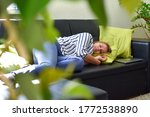 Tired Young Woman Lies On Sofa...