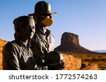 Small photo of WINDOW ROCK, UTAH/USA - JULY 1 2020 : Two of three statues of the Native American family outside of Monument Valley wear face masks for COVID-19, the mother is unmasked, the park is closed.