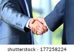 two businessman shaking hands | Shutterstock . vector #177258224