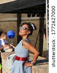 Small photo of Senigallia,Italy 12 August 2019 is an international music festival focused on the US music and culture of the fifties. In the photo: people dressed up in the 50s style / Summer Jamboree