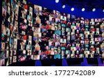 Small photo of Blur large LED screen show many people's faces join big online event or virtual reality live conference. Big video call seminar, Work from home, Social distancing, New normal event production.