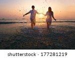 Happy Couple Enjoy Sunset On...