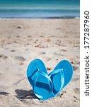 Pair Of Blue Flip Flops On Sand ...