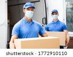 Blue Delivery Men Unloading...