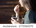asian woman taking pills with...   Shutterstock . vector #1772969270