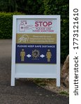 Small photo of COVID-19 board pavement sign, July 04, 2020, Callow End, England