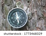 Round Compass On Natural Woode...