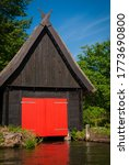 Small Wooden House With Red...