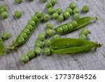 Fresh Green Peas On A Wooden...