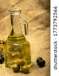 A Glass Bottle Of Olive Oil On...