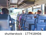 View from inside the bus with passengers. - stock photo
