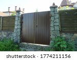 One Brown Iron Gate And Part Of ...