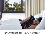 young woman sleeping in the bed  | Shutterstock . vector #177439814