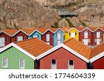 Colorful Boathouses In Row On...