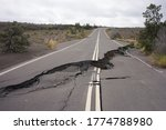Small photo of Asphalt road damaged by the volcanic eruption of Kilauea and caldera collapse with subsequent earthquakes in Hawaii Volcanoes National Park on the Big Island.