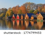 Wooden Boathouses At Lake...