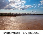 Scenery of Garonne River in Bordeaux France . Flowing Muddy Water . View of Central Bordeaux and River
