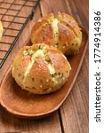 Small photo of Viral and popular bread. Korean cream cheese garlic bread. Bread filled with cream cheese is poured with a garlic butter sauce made from a mixture, garlic, eggs, honey, dried parsley and butter.