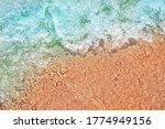 Sea Wave On The Sand Beach ...