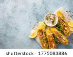Vegan dinner with grilled sweet cob corn top view with copy space Summer vegetarian snacks